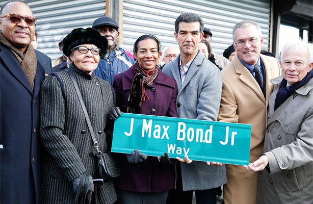 group photo with new street sign