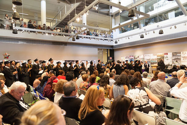 photo: graduation line-up in Spitzer School Gallery