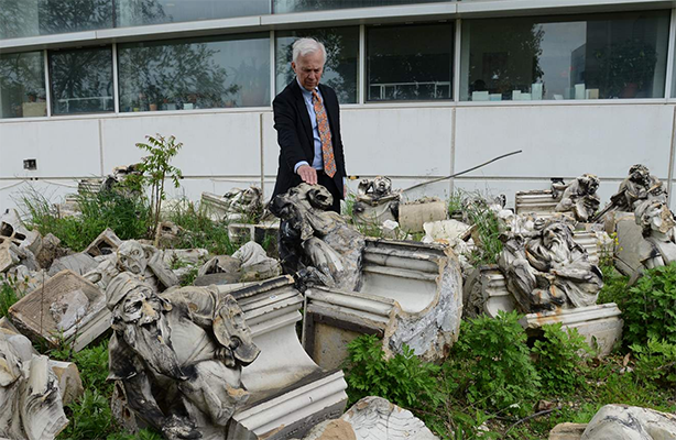 Photo of the Dean with statues
