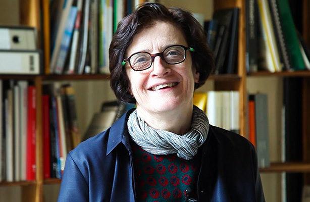 headshot with books in the background: Elisabetta Terragni